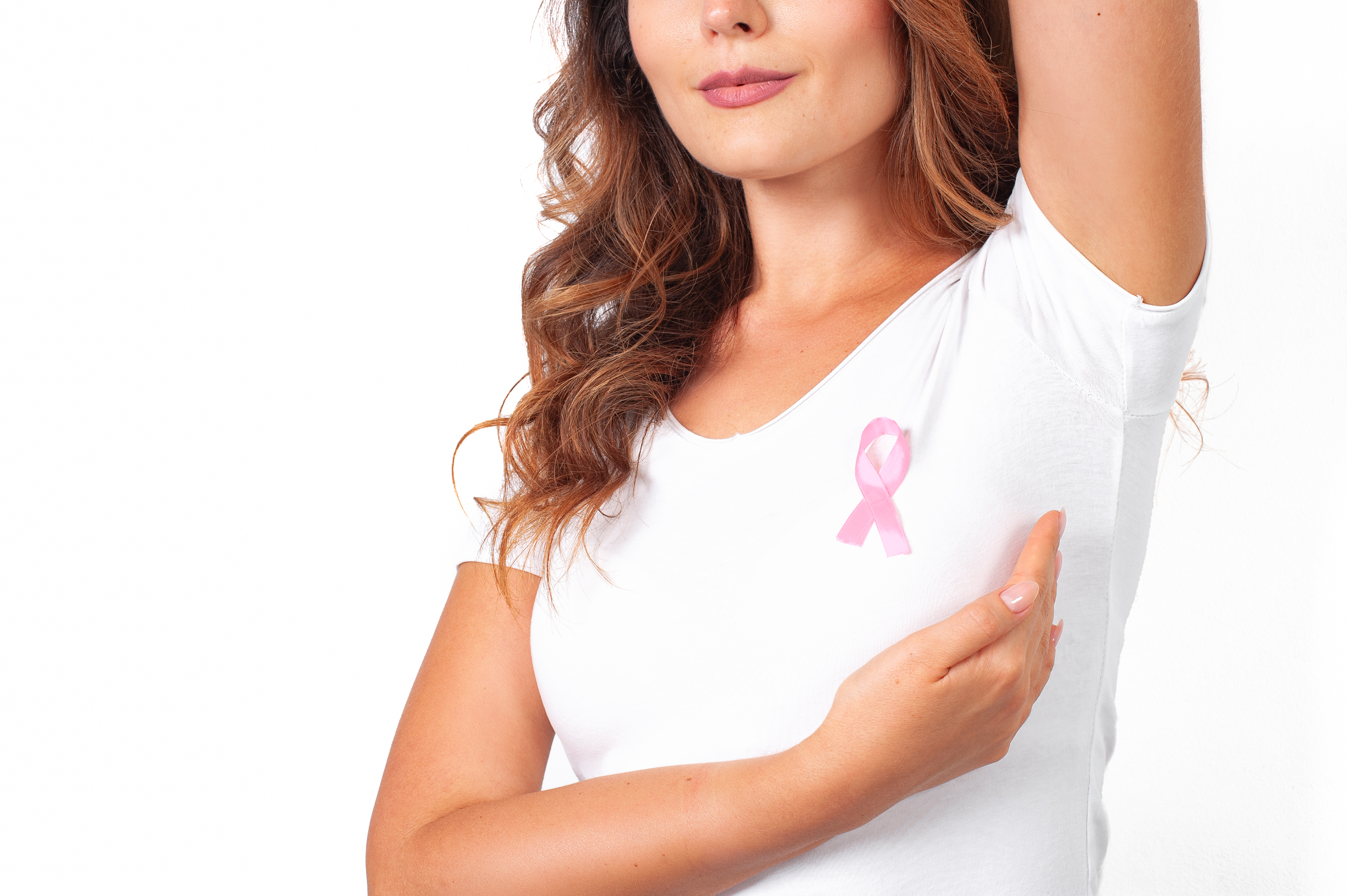 Woman in white t-shirt with pink ribbon supporting breast cancer awareness campaign. Breast Cancer Awareness Month
