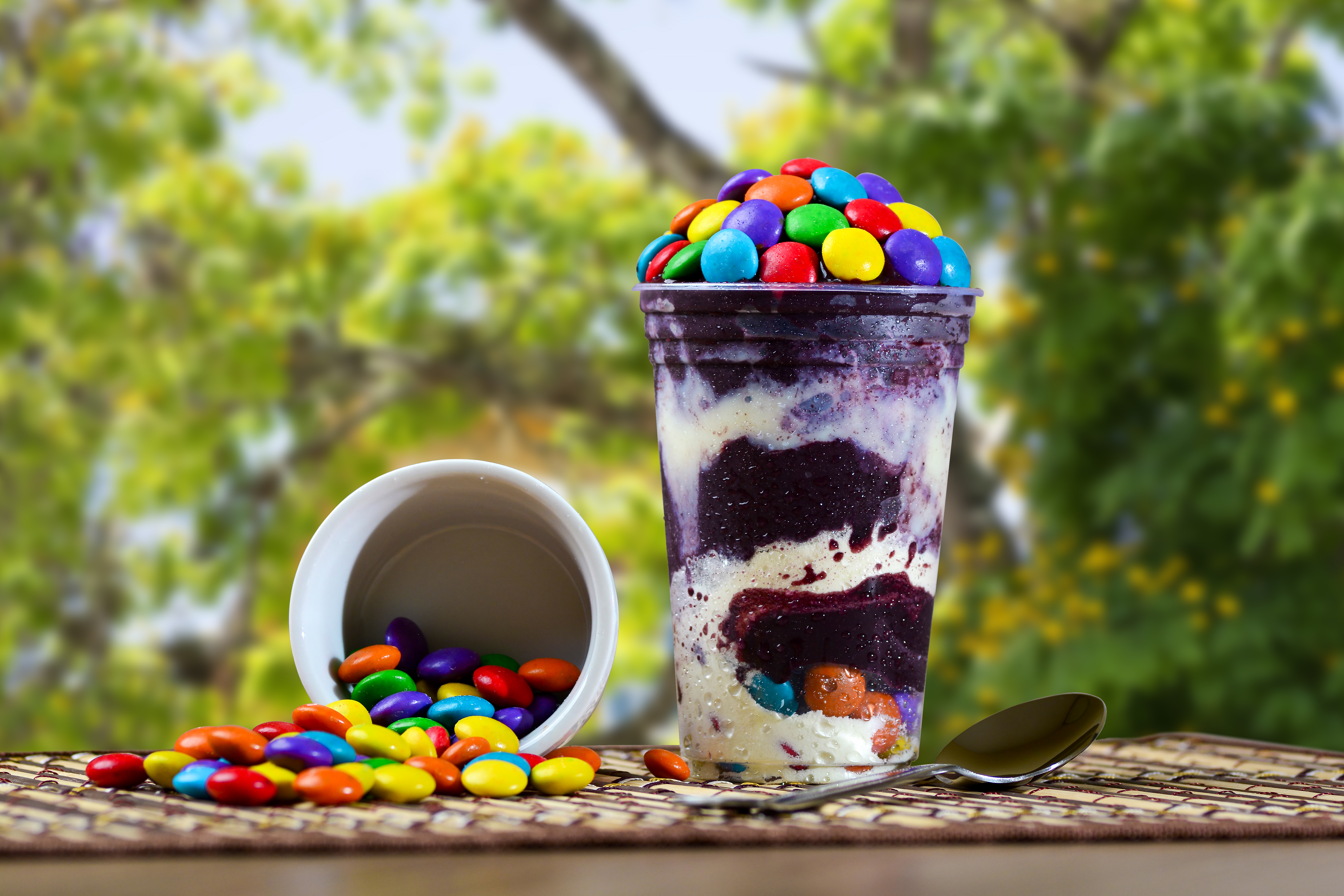 Ice Cream açai Cup with Coated Chocolate Topping, Brazilian Frozen Açai on a purple background